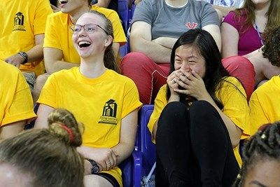 Freshmen Ania Burgess and Lily Green have a good laugh listening to UMass Lowell's 2016 Convcation Speaker at the Tsongas Center.