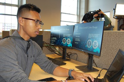 UMass Lowell student Zachary Perlmutter working at the newly-opened Cyber Range center