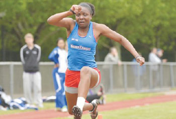 UMass Lowell junior track star Diamond Jones soars in the long jump. The former Lowell High athlete has overcome adversity to shine with the River Hawks.