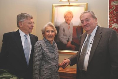 Enterprise Bank Chairman George Duncan, left, Nancy Donahue, and her now-late husband Richard Donahue.