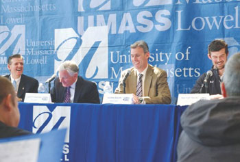 Sharing a laugh at UMass Lowell's media day Wednesday at the Tsongas Center were, from left, Athletic Director Dana Skinner, Chancellor Marty Meehan, coach Norm Bazin and capt. Riley Wetmore. The River Hawks are headed to their first Frozen Four.