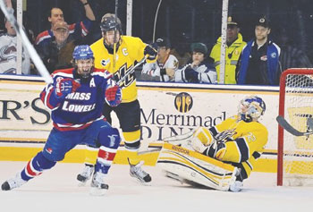 UMass Lowell's Josh Holmsrom scores one of his two goals to lead the River Hawks to a 3-1 win over Merrimack College in North Andover and into sole possession of first place in Hockey East the latest the River Hawks have ever been on top.