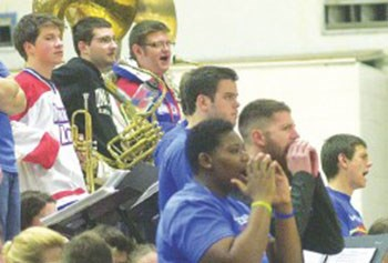 UMass Lowell fans and band members keep an eye on the action at the Costello Athletic Center. Lowell Sun photo by Bob Whitaker