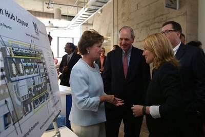 Lt. Gov. Karyn Polito, right, greets UML Chancellor Jacquie Moloney at the opening of UMass Lowell's Innovation Hub and expansion of M2D2 at 110 Canal St. Lowell Sun photo