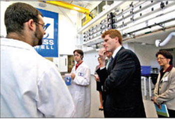 U.S. Rep. Joe Kennedy, center, tours the Mark & Elisia Saab Emerging Technologies and Innovation Center Wednesday. At left are plastics-engineering graduate students Jared Ide and Peter Landers. At right is Julie Chen, vice provost for research. SUN/DAVID H. BROW