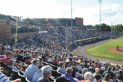 Fans in stands at LeLacheur Park in Lowell.