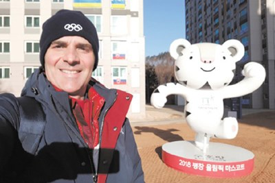 Alexandre Lopes, shown in front of the Olympics mascot, Soohorang the white tiger.,