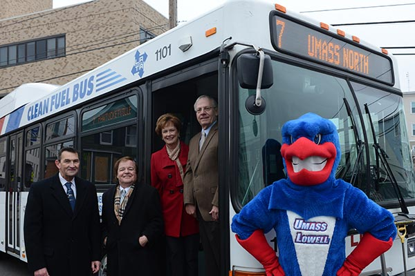 The LRTA unveiled a new transportation program for UMass Lowell students and faculty on Friday. Taking part in the ceremony, from left: UML's Richard Lemoine, LRTA's Jim Scanlan, UML's Jacquie Moloney, LRTA's Philip Shea and Rowdy the River Hawk.