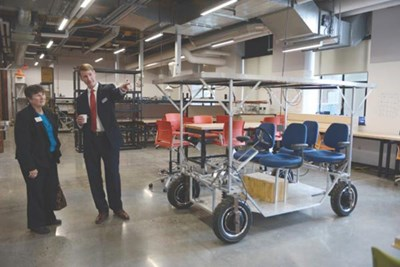 Engineering Dean Joseph Hartman provides a tour of the college's new makerspace to Lisa Derby Oden, project manager of the MassMEP. Tory Germann via UMass Lowell photo