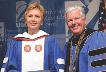 Former Ireland President Mary McAleese joins UMass Lowell Chancellor Marty Meehan as she receives an honorary degree from the university during her visit to the city on Friday.
