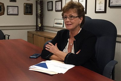 UMass Lowell Chancellor Jacquie Moloney speaks to reporter