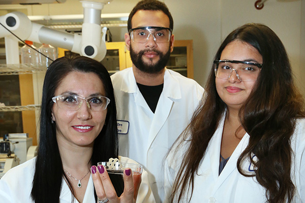 """The overarching goal of our lab research is to improve human health the quality of life and give back to society,"" said Gulden Camci-Unal, left, professor of chemical engineering at UMass Lowell. She s joined by graduate students Darlin Lantigua of Lawrence and Sanika Suvarnapathaki of Lowell."