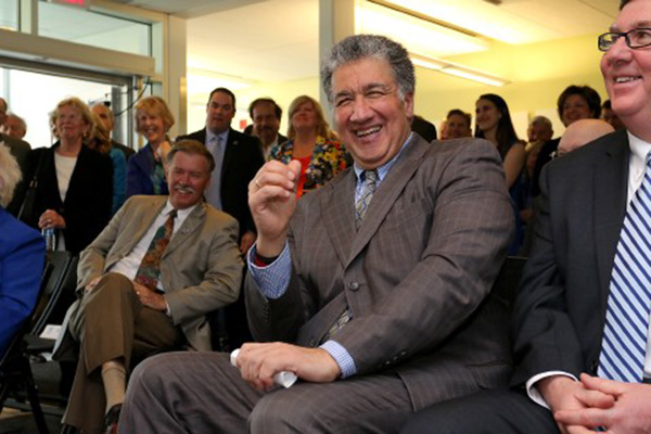 Former State Senator Steven Panagiotakos has a good laugh as he listens to the speakers during the UMass Lowell event Monday. To his left is state Rep. David Nangle. To his right, former City Councilor Curtis LeMay.