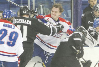 The action during Friday's Hockey East semifinal between UMass Lowell and Providence expects to be fast and furious. In the regular season, UML's Jake Suter, who had lost his helmet, battles against Providence's Tim Schaller. SUN/BOB WHITAKER
