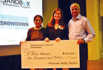 Trisha Blanchet, center, of Chelmsford, is awarded a $10,000 first-place prize for her Operation Canine proposal from the Merrimack Valley Sandbox at UMass Lowell Thursday night. Awarding the grant are Jaishree Deshpande, left, and Desh Deshpande, co-founders of the Deshpande Foundation.