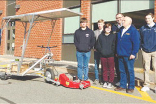 From left, with the prototype of a solar-electric tractor mower, are 2017 graduates Andrew Poutry (Ayer), Spencer Brittain (Pepperell) and Shayna Legros (Chelmsford); Nashoba Tech Vocational Coordinator Paul Jussaume; UMass Lowell Prof. Sam Mil shtein; and senior Connor Walsh (Chelmsford).
