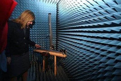 Lt. Gov. Karyn Polito steps inside an anechoic chamber (echo-less chamber) during a visit to the Printed Electronics Research Collaborative at UMass Lowell on Tuesday.