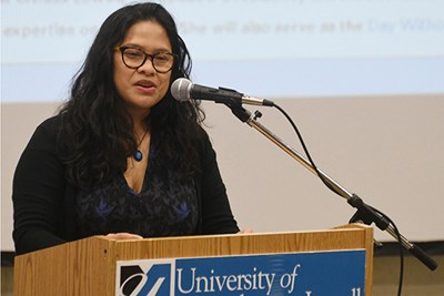 Noy Thrupkaew, an anti-human-trafficking activist and UMass Lowell's 2017 Greeley Scholar for Peace Studies, at podium