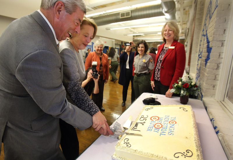 Special Asst. to the UMass Lowell Chancellor Don Pierson and Congresswoman Niki Tsongas cut the anniversary cake with TIHC Director Sheila Kirschbaum's blessing.