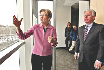 U.S. Sen. Elizabeth Warren gets the lay of the land on the recent improvements at the University of Massachusetts Lowell Tuesday from Chancellor Marty Meehan during a tour of the new Emerging Technologies and Innovation Center.