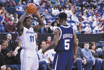 UML guard Akeem Williams, left, shown inbounding the ball vs. UNH, is nearing 2,000 career points.