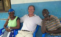 Public Affairs staff writer Geoffrey Douglas spends time with two new friends in Bagamoyo, Tanzania.