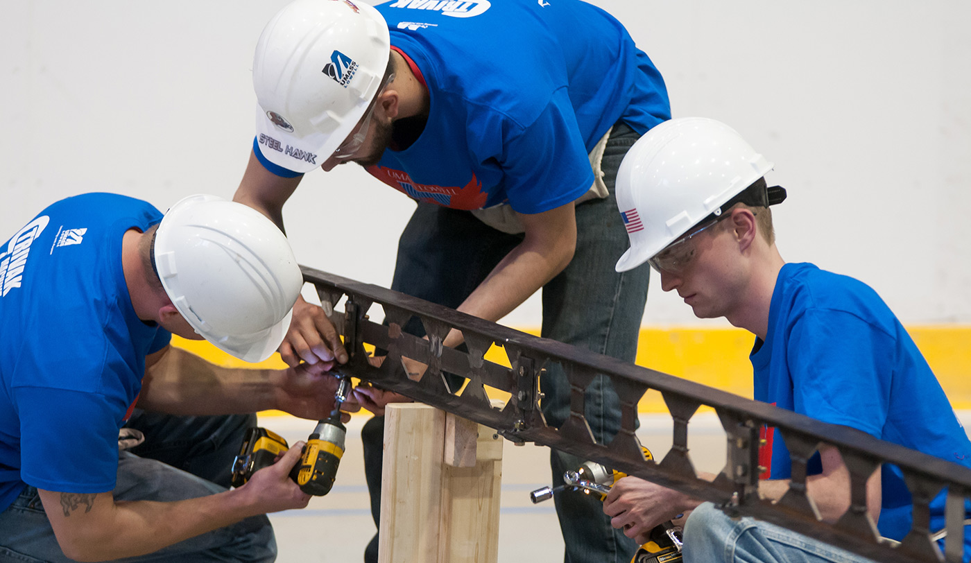 Three UMass Lowell students taking part in the Steel Bridge Competition.