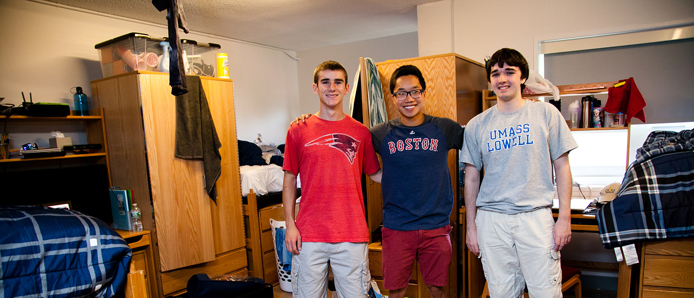 three-male-students-in-room-posing