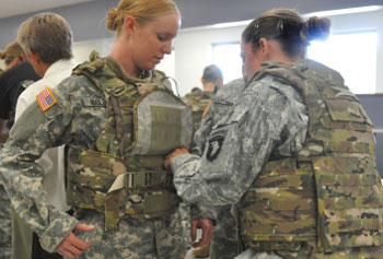 Army Specialst Arielle Mailloux gets some help adjusting her protoype Generation III Improved Outer Tactical Vest from Capt. Lindsey Pawlowski recently at Fort Campbell, Ky. Army photo by Megan Locke Simpson