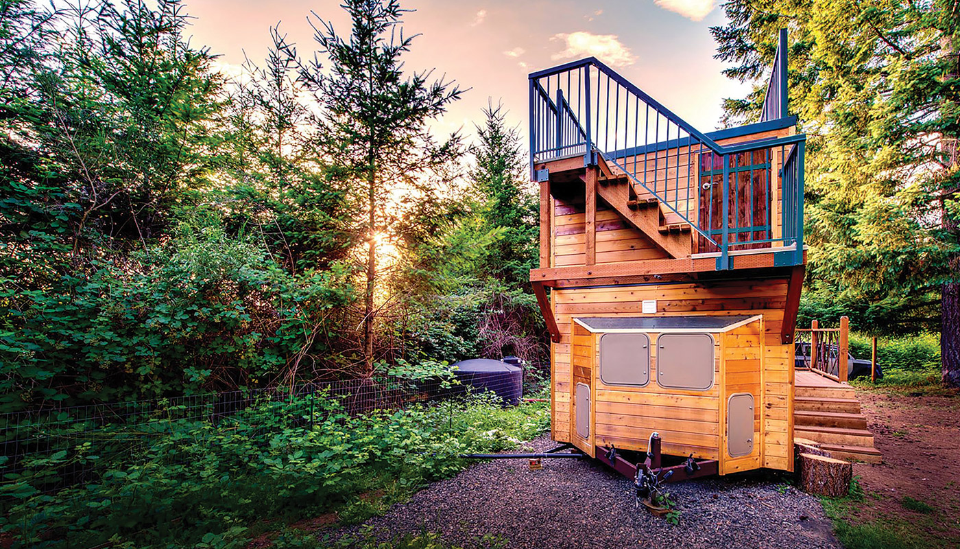 Tiny house designed and lived in by two alums