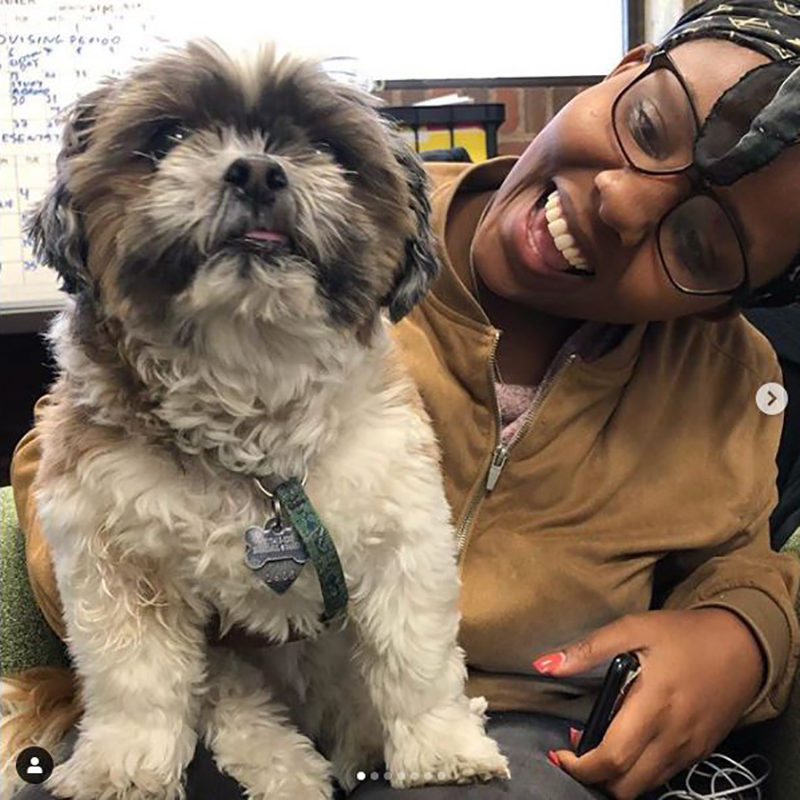 Tippy the dog with smiling student