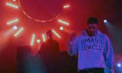 Drake, wearing a UMass Lowell sweatshirt, performs in his sold-out show at the Tsongas Center in October 2010.