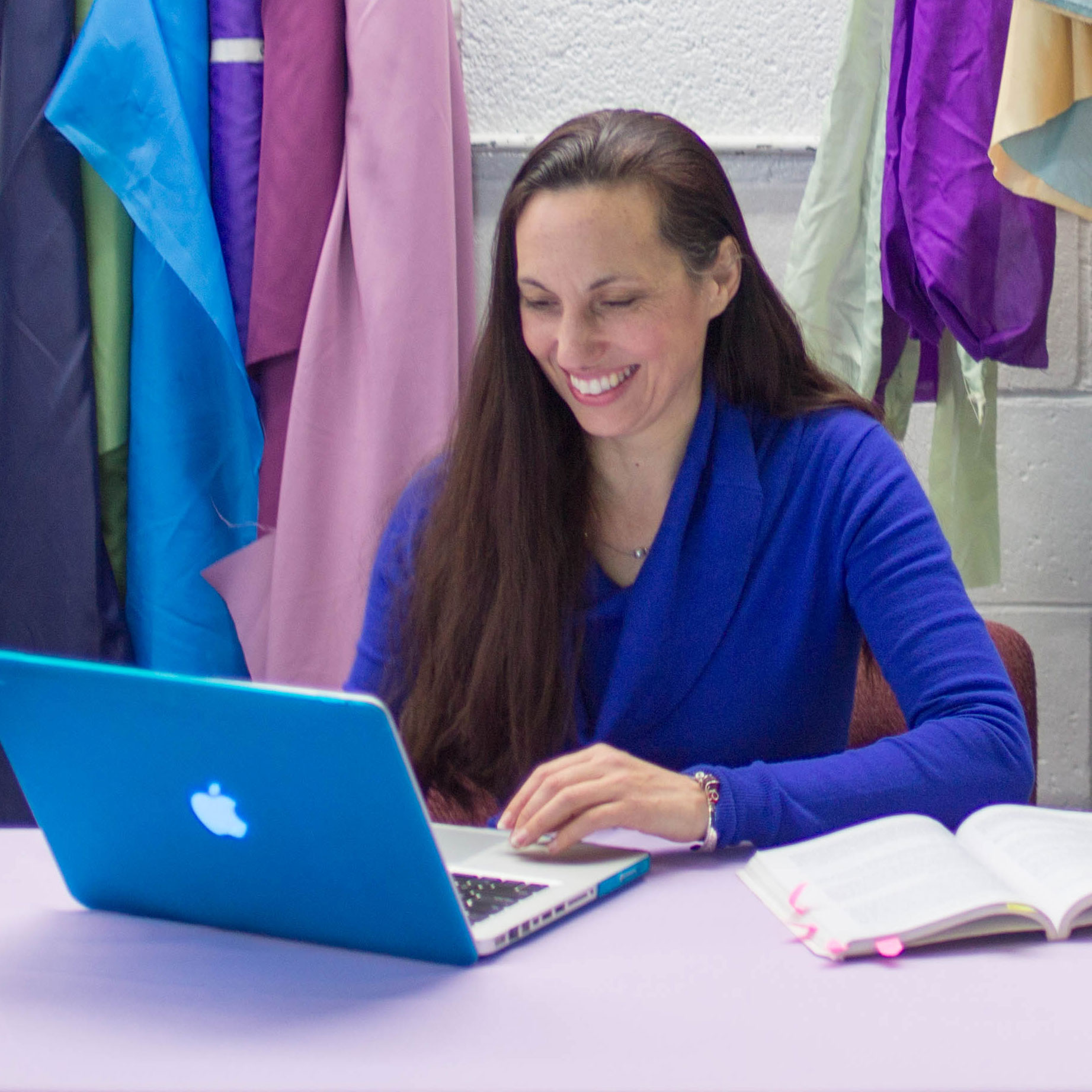 UMass Lowell online student Clarissa Eaton working at a computer