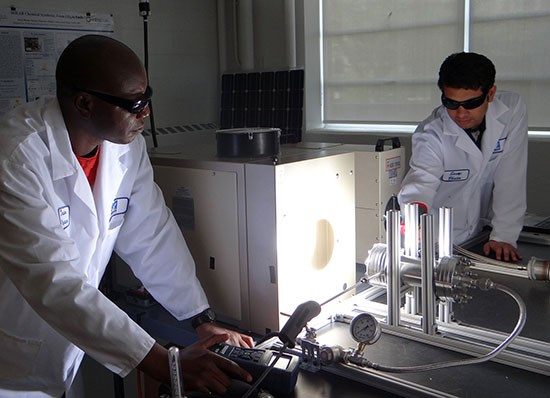 two-male-students-lab-coats-solar-energy-research-550-opt.jpg