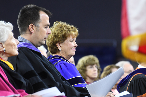 Nancy Donahue, left, speaker Corey Ciocchetti and Chancellor Jacquie Moloney at Convocation.
