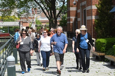 UML University Professor Robert Forrant leads a walking tour of Lowell at the opening of the Global Carework Summit