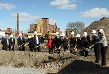 UMass Lowell, state and community leaders break ground on University Suites, a state-of-the art all-suites residence hall set to open in the fall of 2013.