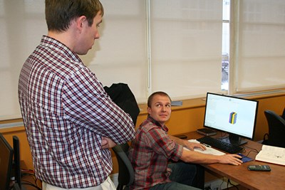 Stephen Johnston speaks with a student in the computer lab