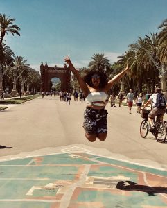 Study abroad student Cloris Lora jumping for joy in Barcelona