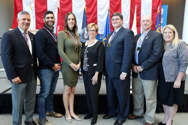 This year's Military Hall of Fame inductees are, from left, Bob Kilmartin, Salvatore DeFranco, Dana DeFranco, UML Chancellor Jacquie Moloney, William O'Donnell, James Carabello and Janine Wert, director of UML's Veteran Services department.