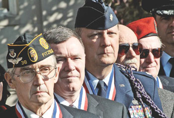 "Members of the Squadron N-12 of the National Society of Pershing Rifles, from left, Al Kulas, Edward ""Skip"" Kittredge, Peter Maravelias, Joe Cartwright and Robert Nadeau, attend a Veterans Day flag-raising ceremony at UMass Lowell."
