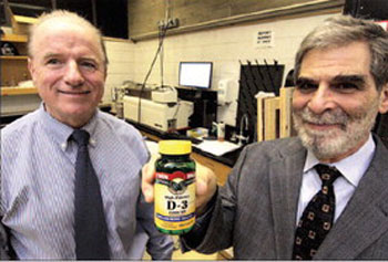 UMass Lowell professors Eugene Rogers, left, and Garry Handelman are studying ways to more accurately determine levels of vitamin D in a person's blood.
