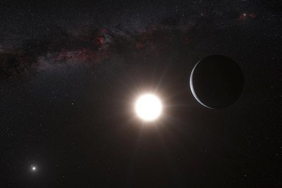An artist's impression shows the planet orbiting the star Alpha Centauri B. Our own sun is in the upper right.