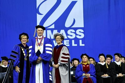 Chancellor Jacqueline Moloney, left, and Interim Provost Julie Chen present a Doctorate of Human Letters to Jack Wilson, looking on are Trustee Mary L. Burns '84 and Therese and Jack O'Connor, Chancellor's Medal for Public Service and Civic Engagement honorees.