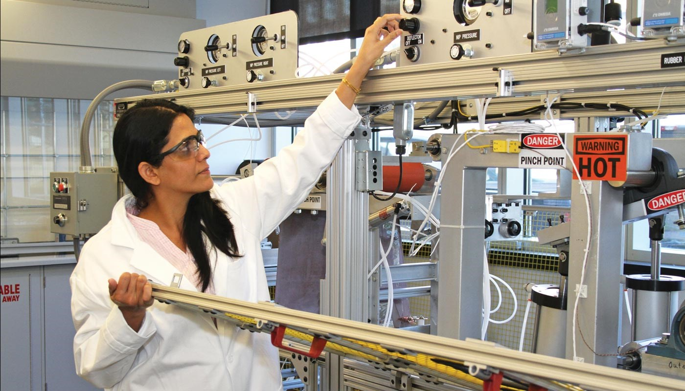 woman adjusting knob on nano equipment
