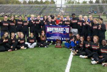Members of the UMass Lowell women's track and field team pose with their hardware after the River Hawks captured another Northeast-10 Championship.