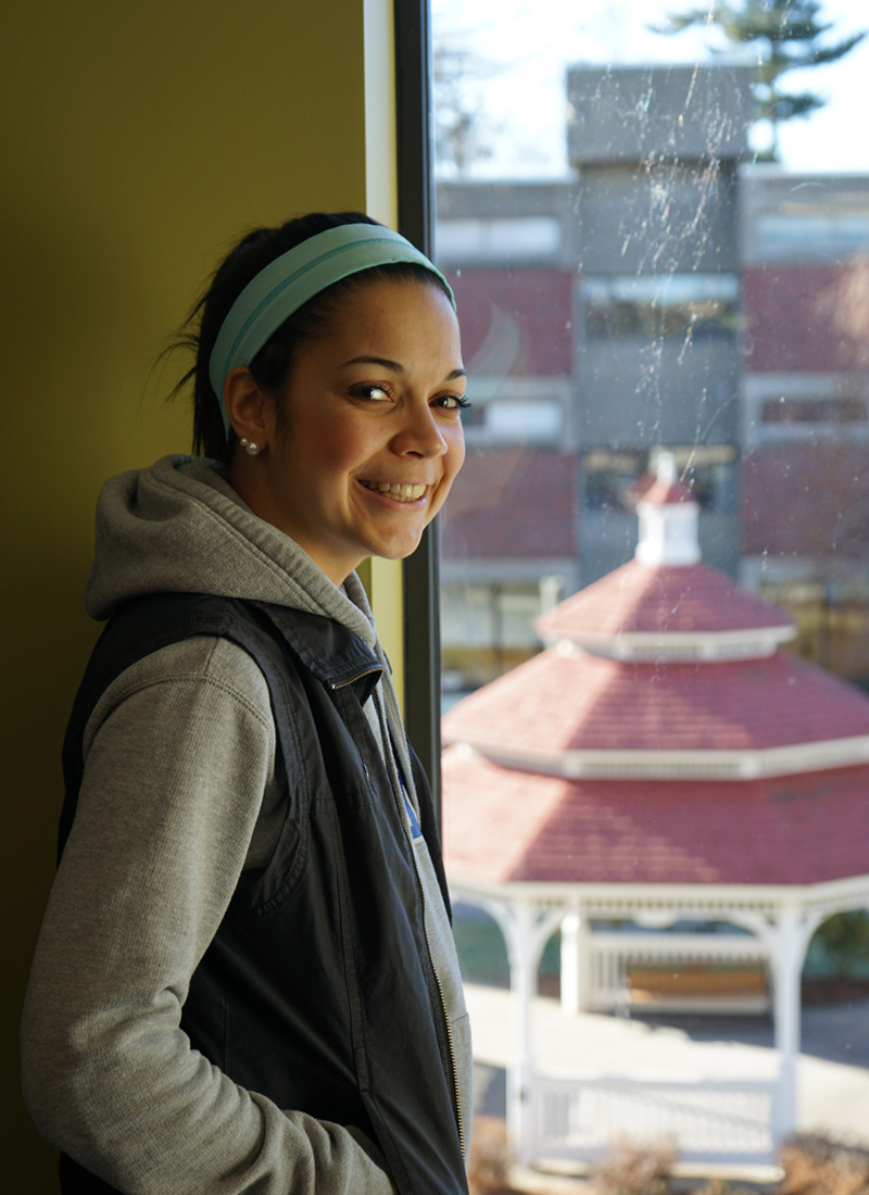 Headshot of Zayna Basma in a building on South Campus looking down on the gazebo