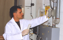 Technician extracting a sample